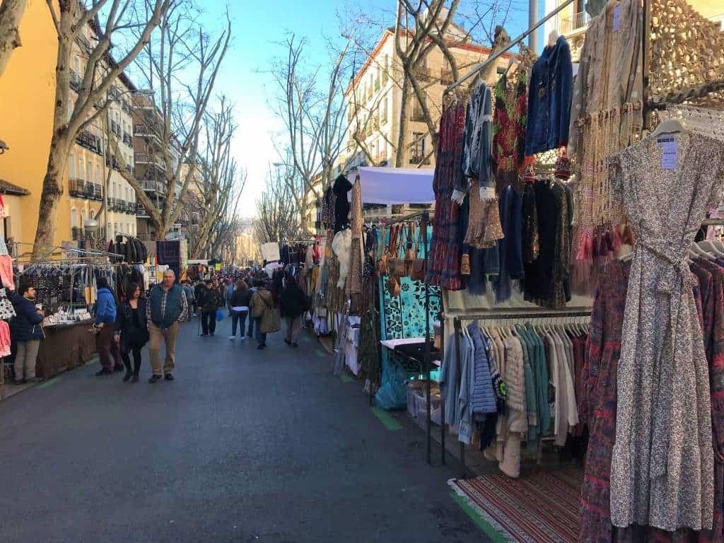Shops set up along the street for the El Rastro flea market.