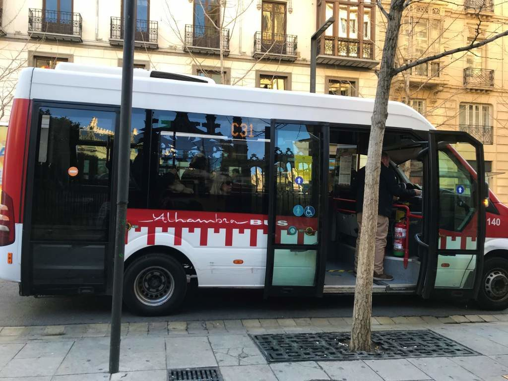 A wheelchair accessible Alhambra Bus on the streets of Granada.