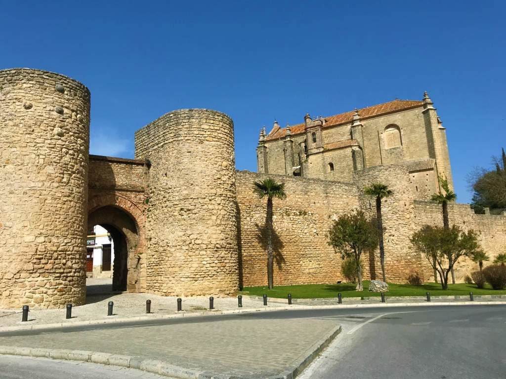 When taking a Seville to Ronda day trip by car, you may park near this stone Almocábar Gate.
