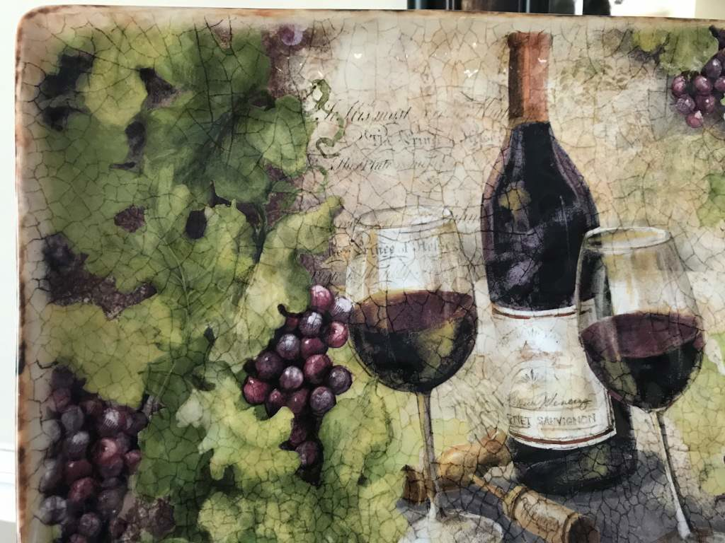 An antique ceramic painting with wine.