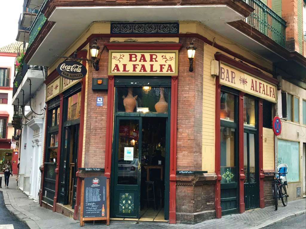 The entrance to Bar Alfalfa, which is located on a street corner.