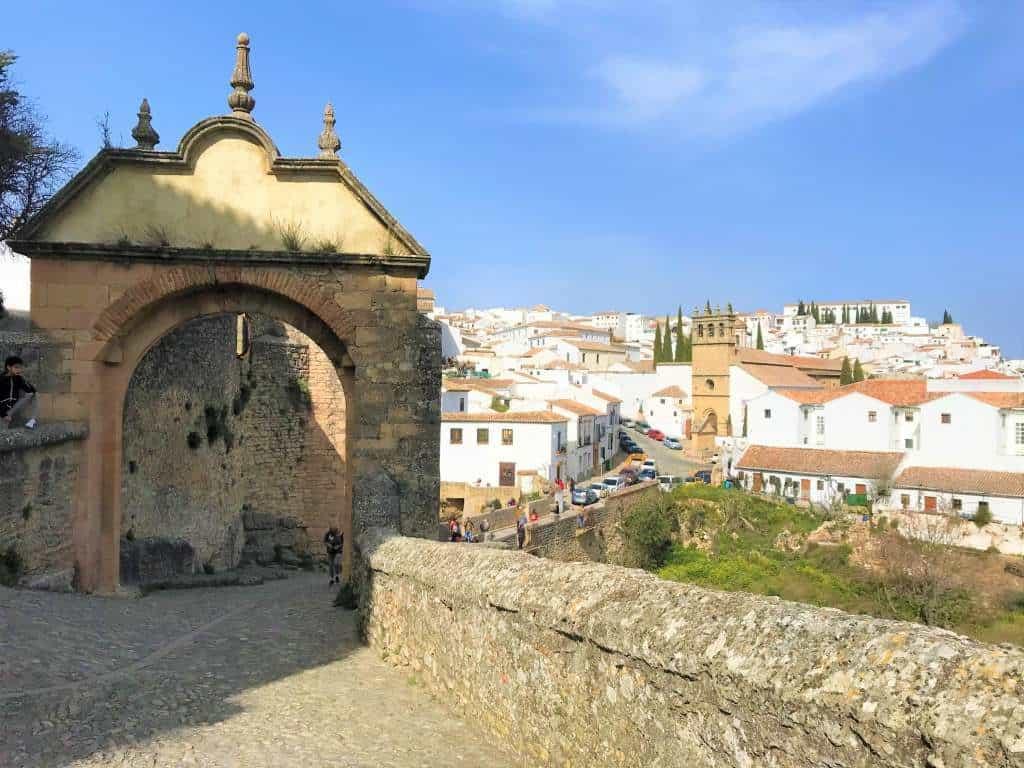 A cobblestone path leading into Ronda's old town.