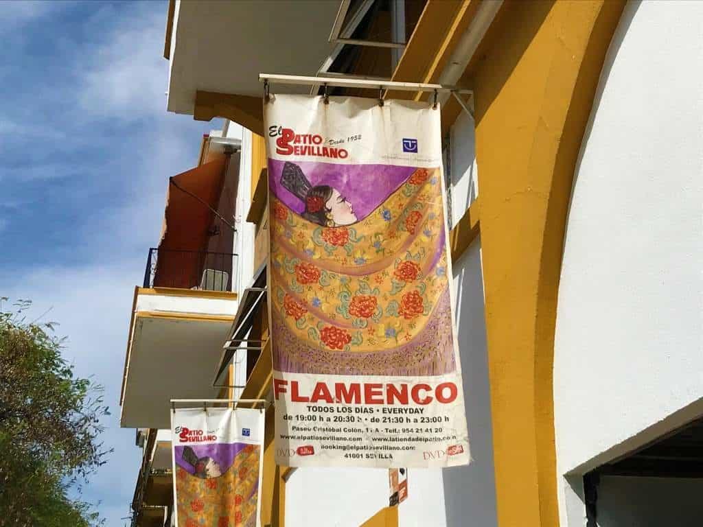 A sign promoting the El Patio Sevillano Flamenco show.