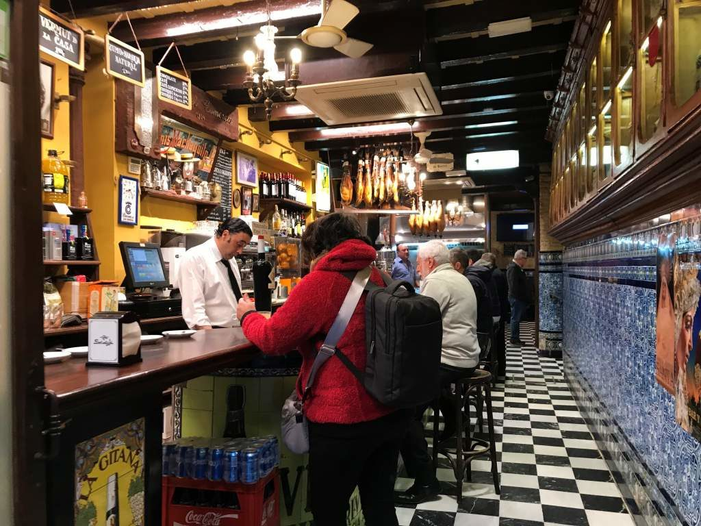 A view of the inside of Bar El Comercio, offering some of the best churros in Seville.