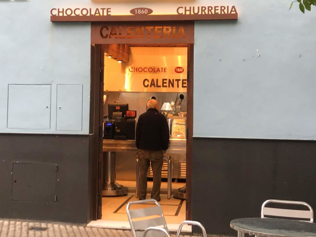 A man ordering at La Calentería, which offers some of the best churros in the historical center of Seville.