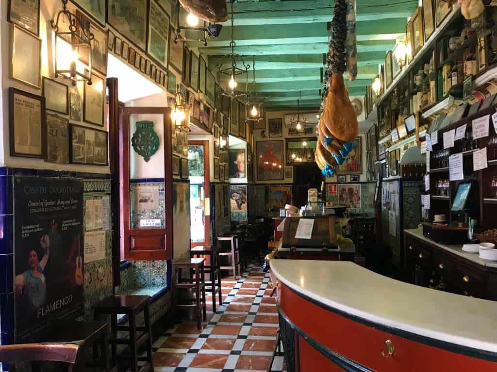 Photos on the walls inside Las Teresas tapas bar.