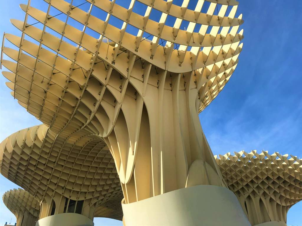 A view of the Metropol Parasol with blue skies.