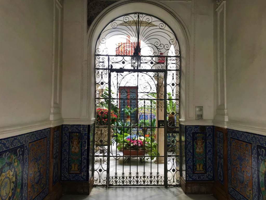 Exploring patios like this one is a one of the wonderful free things to do in Seville.