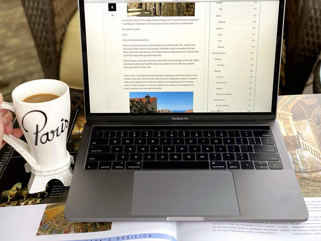 A cup of coffee with a laptop.