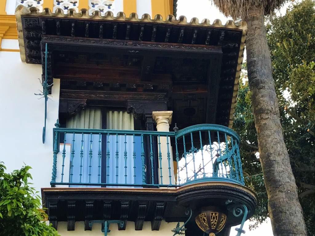 Rosina's Balcony, which has a painted blue railing.