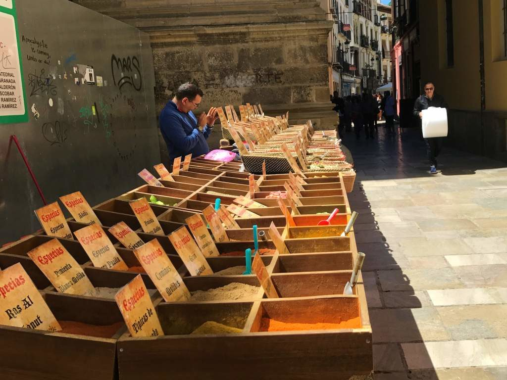 An outdoor spice market beside the Granada Cathedral.