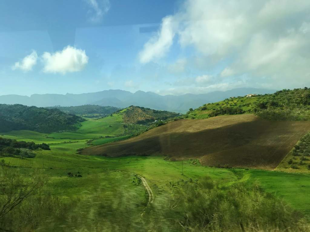 A view of the countryside on the bus taking a day trip from Seville to Ronda.