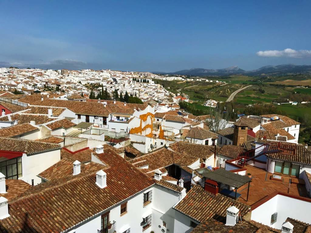 Taking a day trip from Seville to Ronda is a great way to see Ronda's white village, like in this photo.