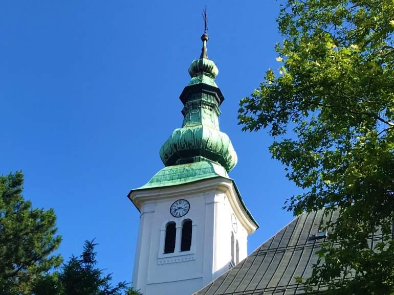 A green church steeple.