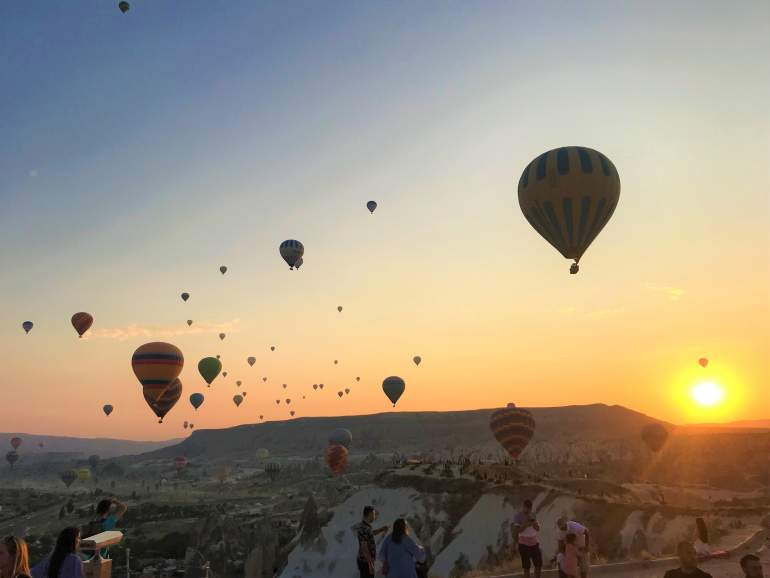 Hot air balloons at sunrise in Cappadocia on a morning when flights aren't cancelled.