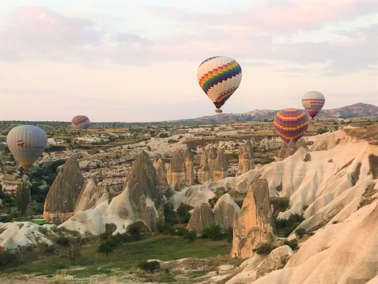 Hot air balloons floating over Love Valley on a morning when Cappadocia hot air balloon rides weren't cancelled.