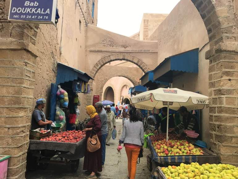 Three apple carts at a market during Ramadan in Morocco.