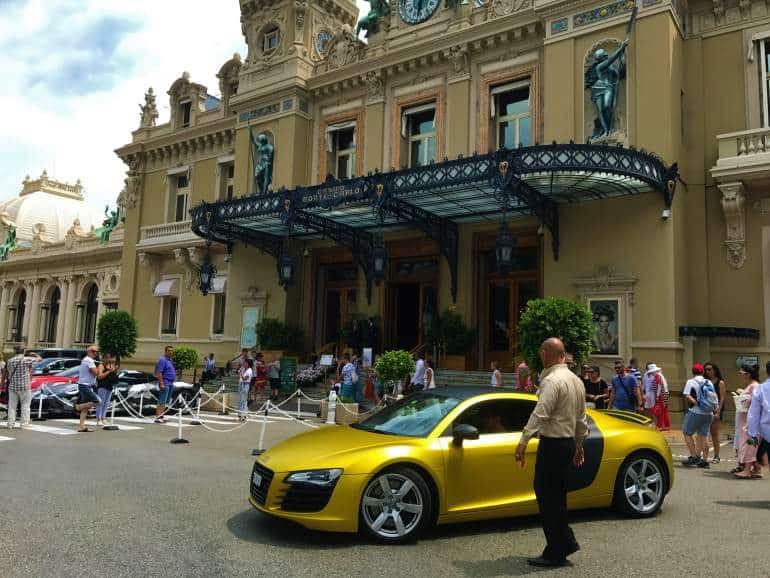 A yellow car in front of the Casino de Monte-Carlo.