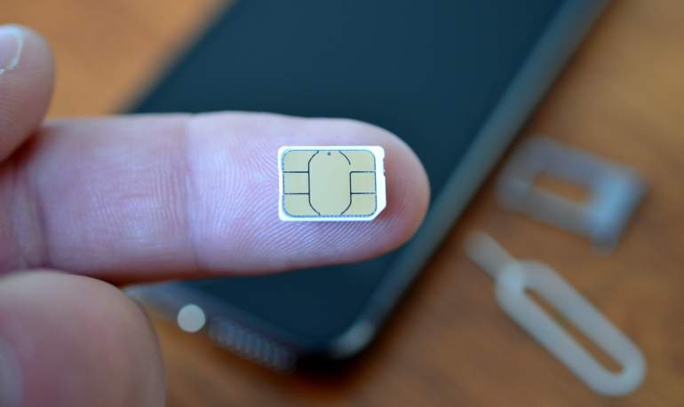 A Morocco SIM card on someone's finger.