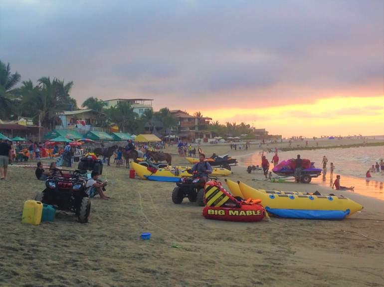 Crowded Mancora Beach at sunset.