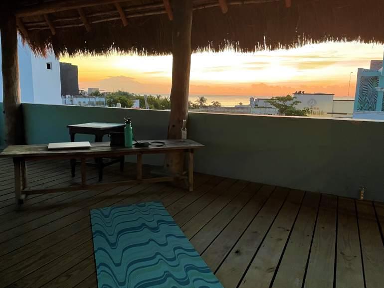 Selina Playa del Carmen activities center at sunrise.