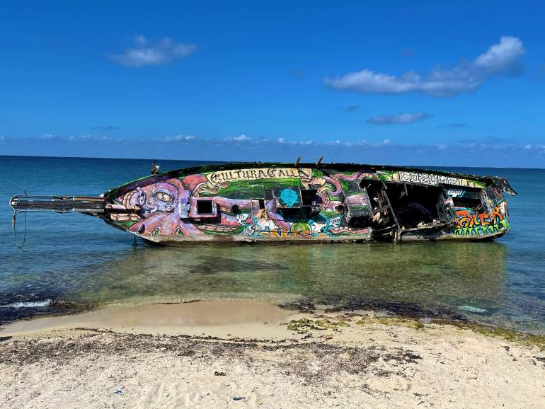 Street art on a sunken ship in Cozumel.