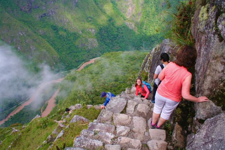 Climbing down Huayna Picchu's staircase, which is steep because of the elevation in Machu Picchu.