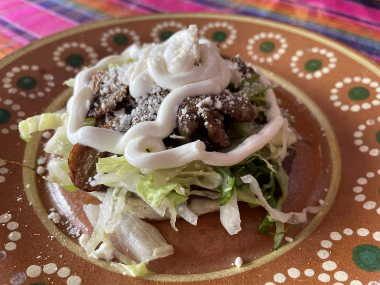 A mushroom sope with lettuce and cream.