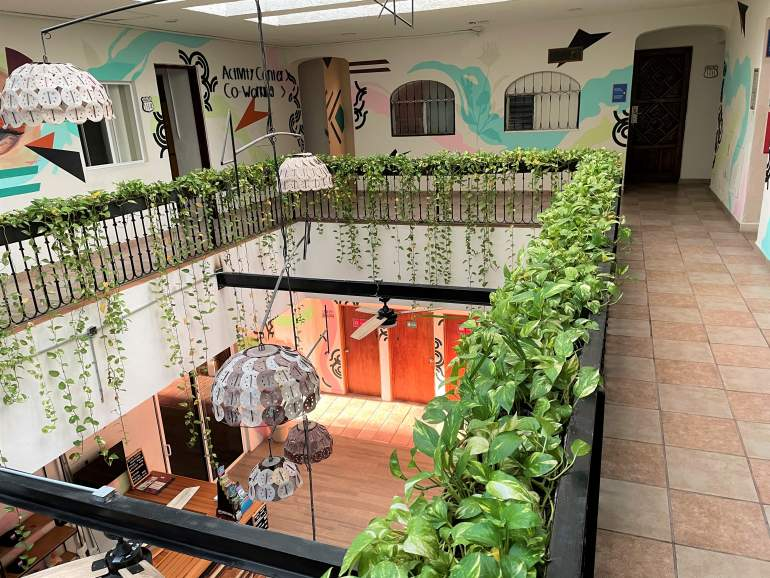 View of the Selina Cancun Downtown lobby from the second floor of the main building.