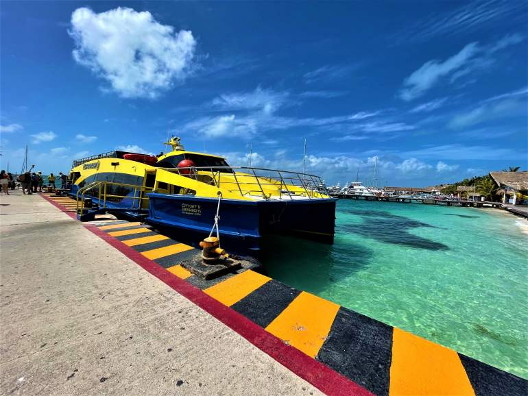 Ferry dock in Isla Mujeres with blue water.