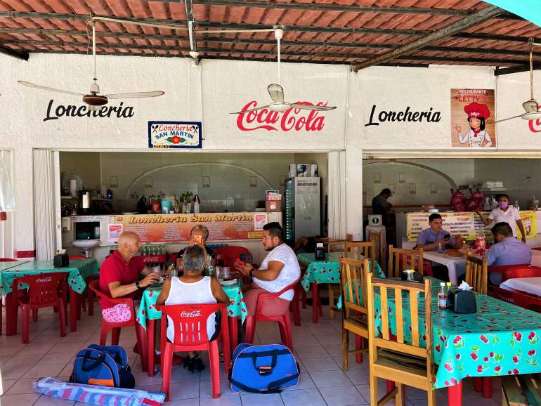 People dining at Lonchería San Martín in Isla Mujeres.