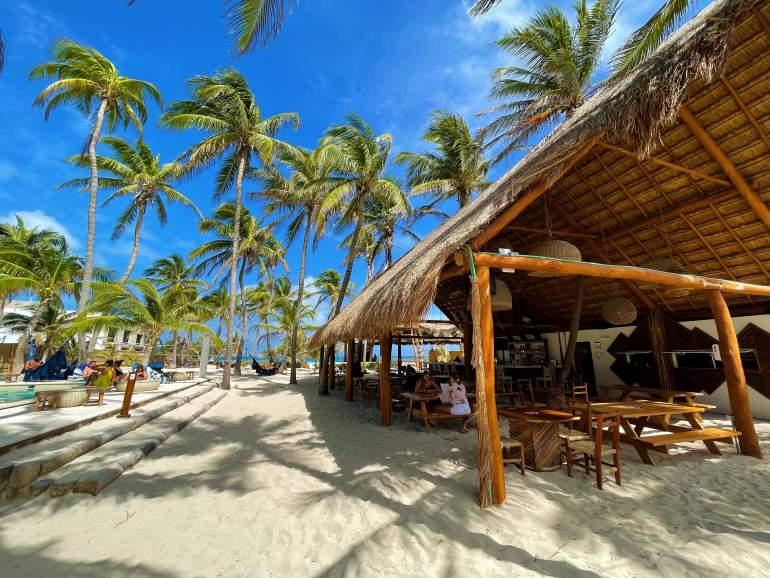 Restaurant, pool, and ocean at Selina Isla Mujeres.
