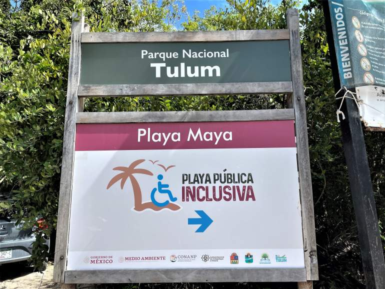 A wheelchair accessible beach sign at Playa Maya in Tulum.