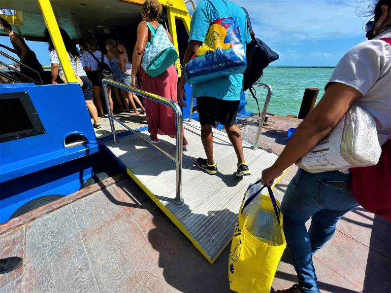 People boarding the Isla Mujeres ferry.