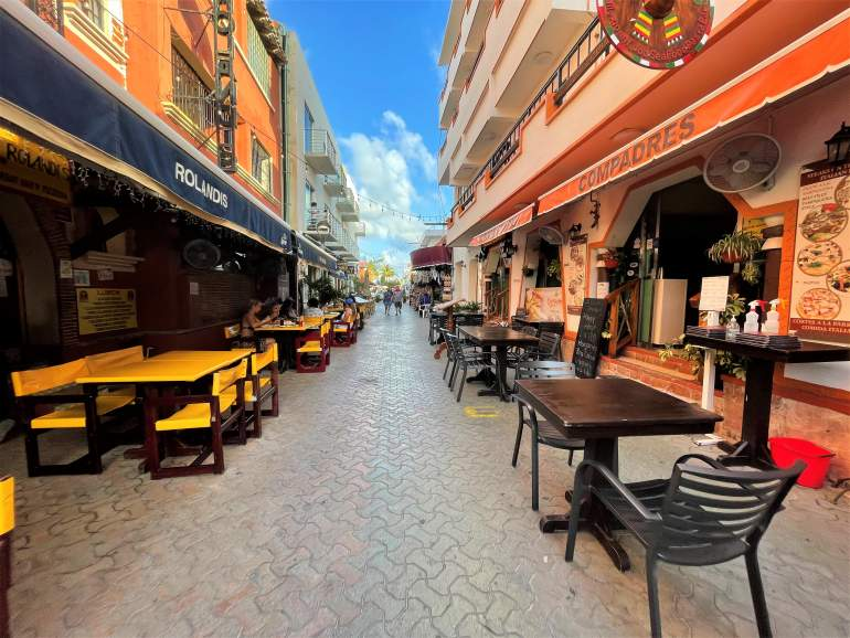 Wheelchair accessible restaurant seating on Miguel Hidalgo Street, Isla Mujeres.