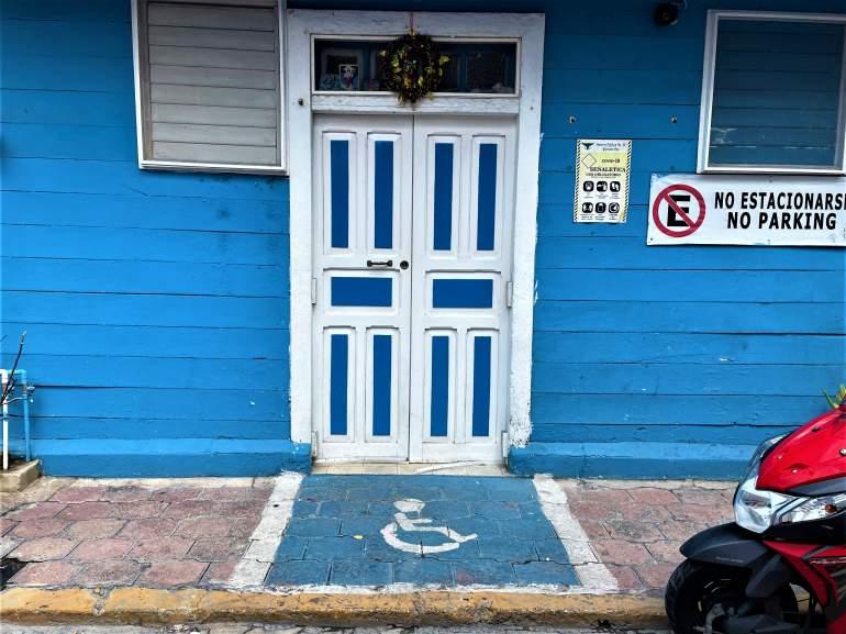Wheelchair painting in front of a door.