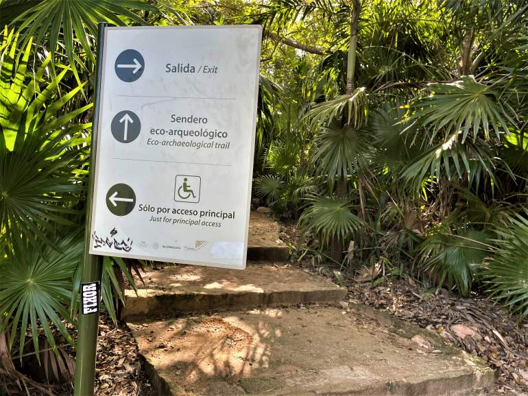Sign pointing to the wheelchair accessible path at the Tulum Ruins.