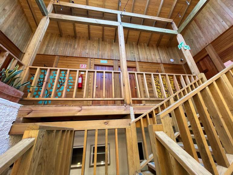 Wooden staircases leading to upper rooms at Selina.