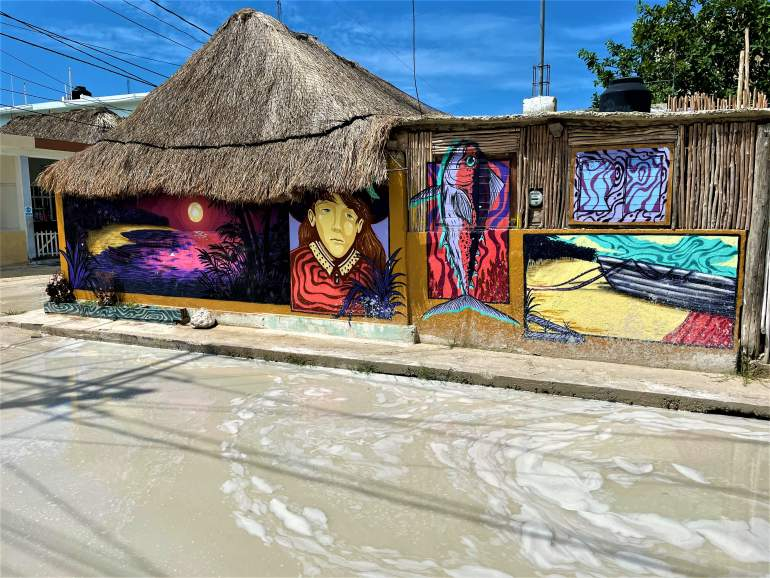 Deep puddles like this one make wheelchair accessibility difficult in Holbox.