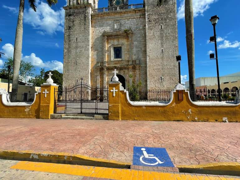 Wheelchair accessible drop-down curb near the Valladolid cathedral.