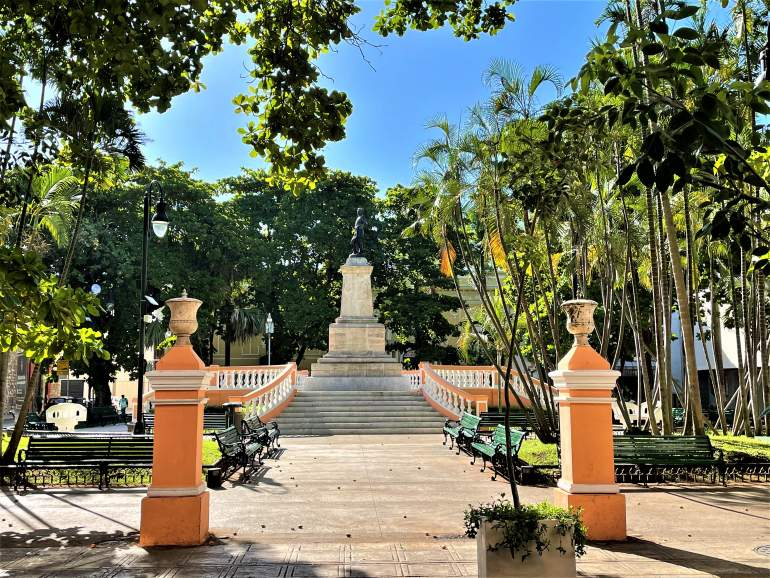 A monument surrounded by orange fencing at Hidalgo Park.