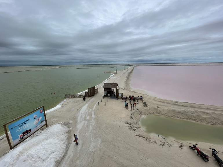A view of the pink lake and ocean from the Las Coloradas lookout tower.