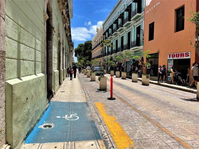 A wide drop curb with a wheelchair logo in downtown Merida.