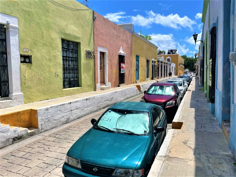 A street in Campeche with such high sidewalks that they have built-in staircases.