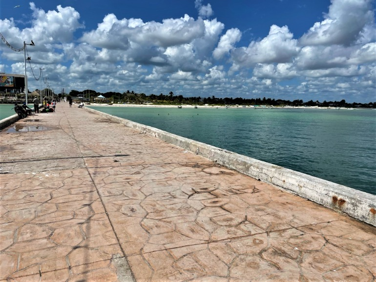 A long wheelchair accessible pier jutting out from Progreso beach.